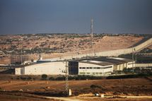 "The Erez border crossing seperating Gaza and Israel is seen on the morning of July 18, 2014 near Sderot, Israel. Late last night the Israel operation ""Protective Edge"" sent troops into Gaza, officially turning the offensive into a ground operation."