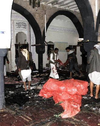 People inspect the crime scene at Al-Hashoush Mosque after a bombing attack in Al Jaraf region of Sana'a, Yemen on March 20, 2015. At least 55 people were killed on Friday in two bombings targeting Houthi mosques in Yemeni capital Sanaa, a medical source has said. The two blasts struck the Badr and Al-Hashoush mosques frequented by supporters of the Shiite Houthi militants. (Photo by Mohammed Hamoud/Anadolu Agency/Getty Images)