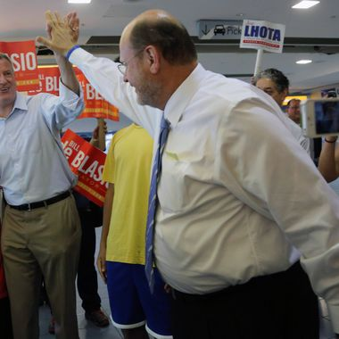 Republican mayoral candidate Joe Lhota, right, greets Democratic mayoral hopeful Bill de Blasio at the Staten Island ferry terminal, Wednesday, Sept. 4, 2013 in New York. Both men were campaigning at the terminal at the same time.