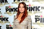 Actress Lindsay Lohan arrives at Mr. Pink Ginseng Drink Launch Party on October 11, 2012 in Beverly Hills, California.