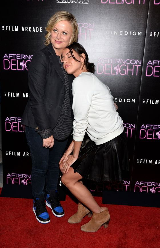 """HOLLYWOOD, CA - AUGUST 19:  Actresses Amy Poehler (L) and Aubrey Plaza arrrive at the Los Angeles premiere of """"Afternoon Delight"""" at ArcLight Hollywood on August 19, 2013 in Hollywood, California.  (Photo by Amanda Edwards/WireImage)"""
