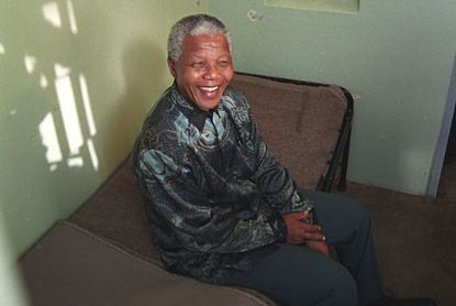 Circa 1995, President Nelson Mandela in a prison cell on Robben Island, where he spent twenty years.
