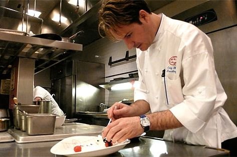 Hopson, at work in his full-time kitchen.