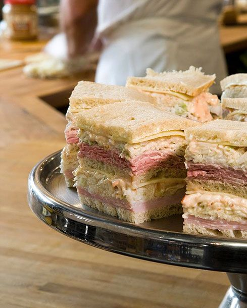 "<b>The Region:</b> South Orange and Millburn, New Jersey  <b>Where to Get It: </b><a href=""http://www.townhalldeli.com/"">Town Hall Deli</a>, <a href=""http://www.millburndeli.com/"">Millburn Deli</a>  This towering triple-decker has nothing to do with mystery meat or tomato sauce. Instead, at certain northern New Jersey delis, a sloppy joe is made with three slices of light rye, two house-roasted meats of your choice (roast beef and turkey is a popular combo, though tongue and pastrami are legitimate as well), Swiss cheese, coleslaw, and Russian dressing. At the Town Hall Deli, owner Tony Wonski — who says he invented the sandwich — uses super-secret homemade Russian dressing and brined coleslaw, made without mayonnaise. The result is juicy, tangy, crunchy, and absolutely nothing like the joes of our teenage cafeteria nightmares."