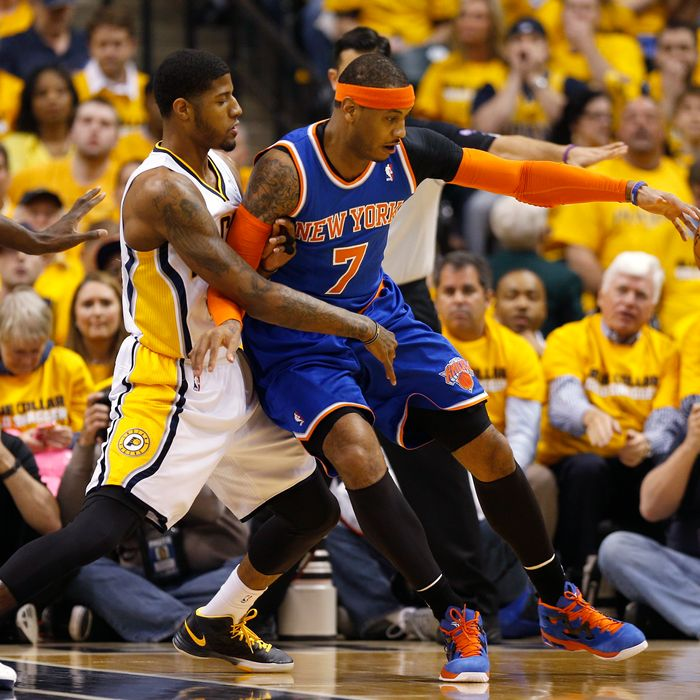 INDIANAPOLIS, IN - MAY 11: Carmelo Anthony #7 of the New York Knicks handles the ball against Paul George #24 of the Indiana Pacers during game three of the Eastern Conference Semifinals of the 2013 NBA Playoffs at Bankers Life Fieldhouse on May 11, 2013 in Indianapolis, Indiana. NOTE TO USER: User expressly acknowledges and agrees that, by downloading and or using this photograph, User is consenting to the terms and conditions of the Getty Images License Agreement. (Photo by Joe Robbins/Getty Images)