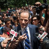 Former New York Gov. Eliot Spitzer is mobbed by reporters while attempting to collect signatures to run for comptroller of New York City on July 8, 2013 in New York City.