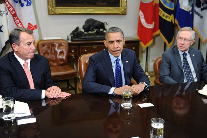 U.S. President Barack Obama (C) speaks as Speaker of the House John Boehner (R-OH) (L) and Senate Majority Leader Harry Reid (D-NV) looks on during a meeting with bipartisan group of congressional leaders in the Roosevelt Room of the White House on November 16, 2012 in Washington, DC. Obama and congressional leaders of both parties are meeting to reportedly discuss deficit reduction before the tax increases and automatic spending cuts go into affect in the new year.