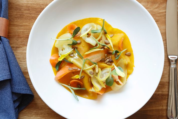 Carrot crêpe with surf clams and sunflower.