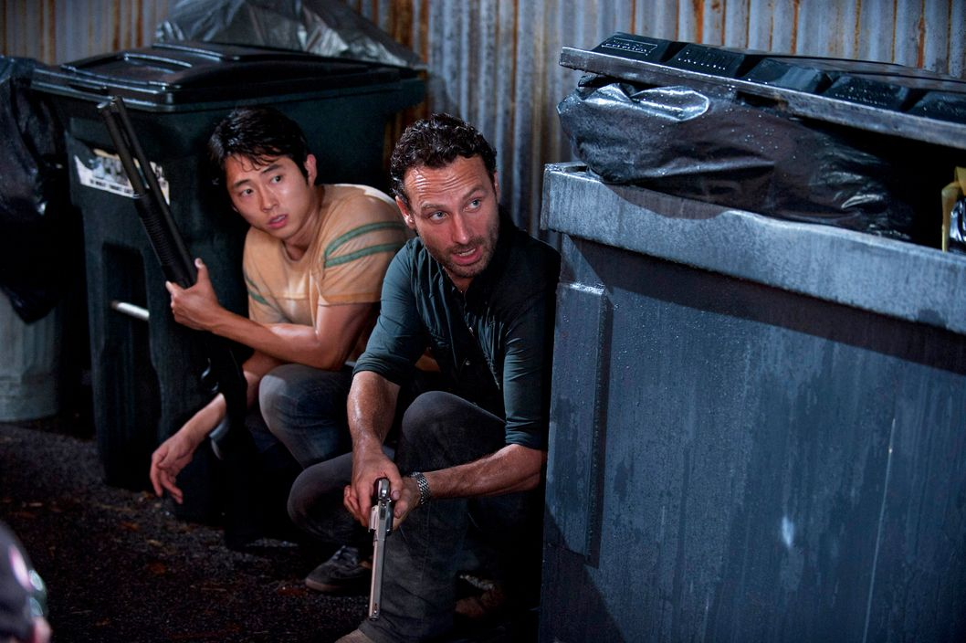 Glenn (Steven Yeun) and Rick Grimes (Andrew Lincoln) - Walking Dead - Season 2, Episode 9 - Photo Credit:  Gene Page/AMC