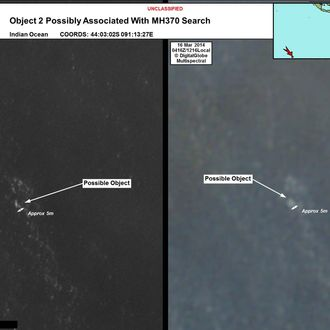 INDIAN OCEAN - In this handout Satellite image made available by the AMSA (Australian Maritime Safety Authority) on March 20, 2014, objects that may be possible debris of the missing Malaysia Airlines Flight MH370 are shown in a revised area 185 km to the south east of the original search area. The imagery has been analysed by specialists in Australian GeoSpacial-Intelligence Organisation and is considered to provide a possible sighting of objects that has resulted in a refinement of the search area. Two objects possibly connected to the search for the passenger liner, missing for nearly two weeks after disappearing on a flight from Kuala Lumpur, Malaysia to Beijing, have been spotted in the southern Indian Ocean, according to published reports quoting Australian Prime Minister Tony Abbott. (Photo by DigitalGlobe/AMSA via Getty Images)
