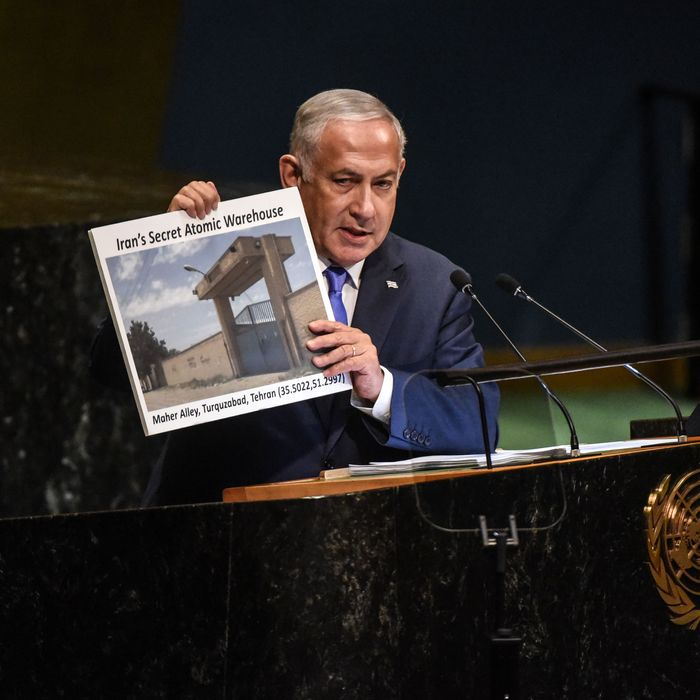 Benjamin Netanyahu, Prime Minister of Israel holds up a placard of a suspected Iranian atomic site while delivering a speech at the United Nations.