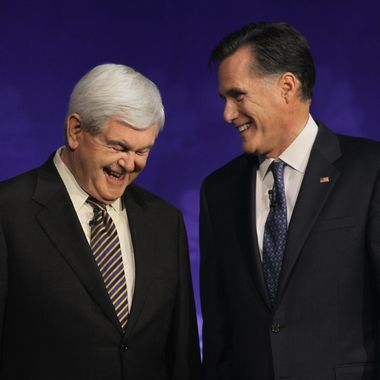 Newt Gingrich and Mitt Romney chat before a debate on November 9, 2011 in Rochester, Michigan.