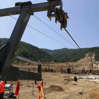 In this Aug. 23, 2013 photo, North Korean soldiers work on at building project to construct a ski resort at North Korea's Masik Pass. North Korean authorities have been encouraging a broader interest in sports in the country, both at the elite and recreational levels, as a means of energizing and mobilizing the masses, which North Korea's slogan spinners are calling