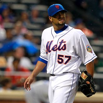 Johan Santana #57 of the New York Mets walks back to the dugout after the final out of the second-inning during the game against the Los Angeles Dodgers at CitiField on July 20, 2012 in the Flushing neighborhood of the Queens borough of New York City.