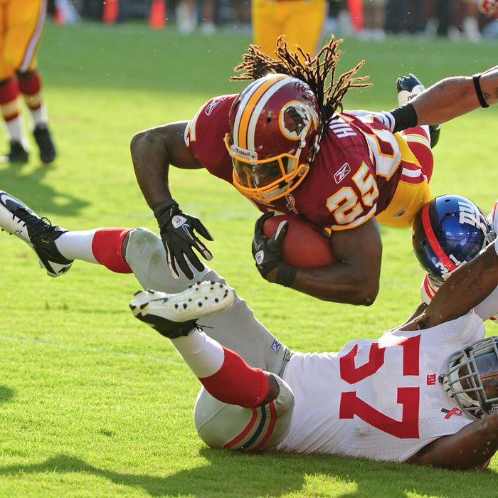 LANDOVER, MD - SEPTEMBER 11: Tim Hightower #25 of the Washington Redskins carries the ball against Jacquain Williams #57 of the New York Giants season-opening game at FedEx Field on September 11, 2011 in Landover, Maryland. (Photo by Scott Cunningham/Getty Images)