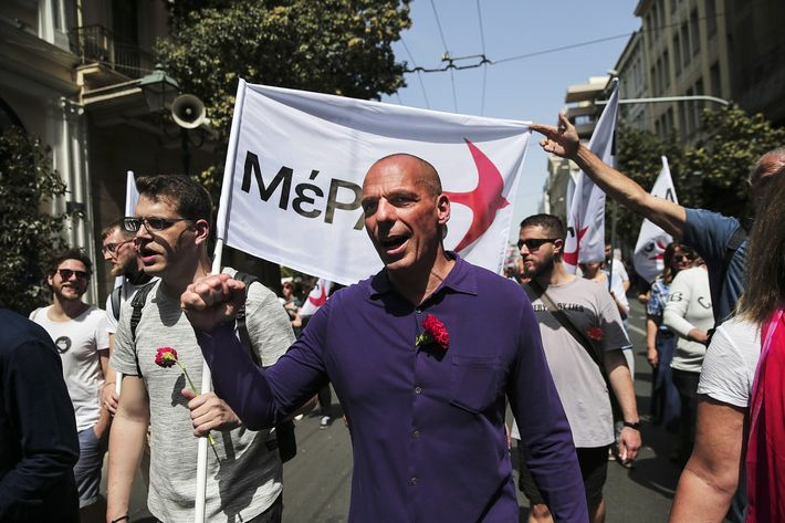 Former Greek Finance Minister Yanis Varoufakis (C) takes part in a rally during May Day celebrations in Athens, Greece, on 01 May 2018.