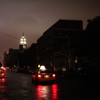 NEW YORK, NY - OCTOBER 29: Power outage seen on October 29, 2012 in Manhattan, New York. Hurricane Sandy, which threatens 50 million people in the Mid-Atlantic area of the United States, is expected to bring days of rain, high winds and possibly heavy snow. New York Governor Andrew Cuomo announced the closure of all New York City bus, subway and commuter rail services as of Sunday evening. (Photo by Allison Joyce/Getty Images)