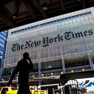 NEW YORK - APRIL 21: A man speaks on his mobile phone across from The New York Times headquarters building April 21, 2011 in New York City. The New York Times profits fell 58 percent in the first quarter of 2011. (Photo by Ramin Talaie/Getty Images)