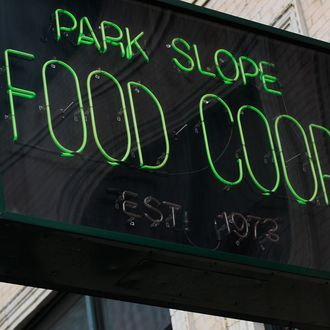 NEW YORK - SEPTEMBER 17: A sign for the Park Slope Food Coop on September 17, 2010 in the Brooklyn borough of New York City. The Park Slope Food Coop, where shoppers must work periodic shifts at the grocery store in order to buy there. The Coop has been named the largest consumer-owned single-store Cooperative by sales in the U.S., tallying $39.4 million during its last fiscal year. (Photo by Chris Hondros/Getty Images)