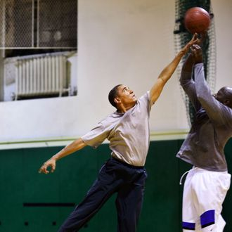 President Barack Obama plays basketball with personal aide Reggie Love at St Bartholomew's Church in New York City, where the President is attending the United Nations General Assembly, Sept. 23, 2009.