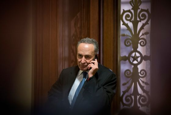 "Sen. Charles Schumer, D-N.Y., third ranking in the Senate Democratic leadership, speaks on his cell phone following a closed-door caucus discussing how to avoid the ""fiscal cliff"" of automatic tax increases and deep spending cuts that could kick in Jan. 1., at the Capitol in Washington, Sunday, Dec. 30, 2012.   (AP Photo/J. Scott Applewhite)"
