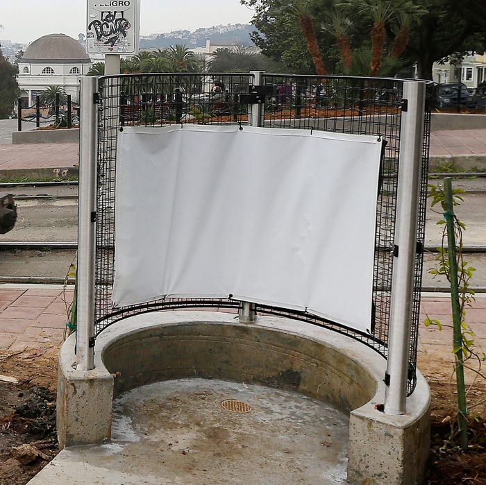 A MUNI streetcar approaches a stop across from Dolores park next to an outdoor urinal in San Francisco, Thursday, Jan. 28, 2016. The popular San Francisco park this week has reopened with renovations and the new public urinal, the latest move to combat public urination in the city. (AP Photo/Jeff Chiu)