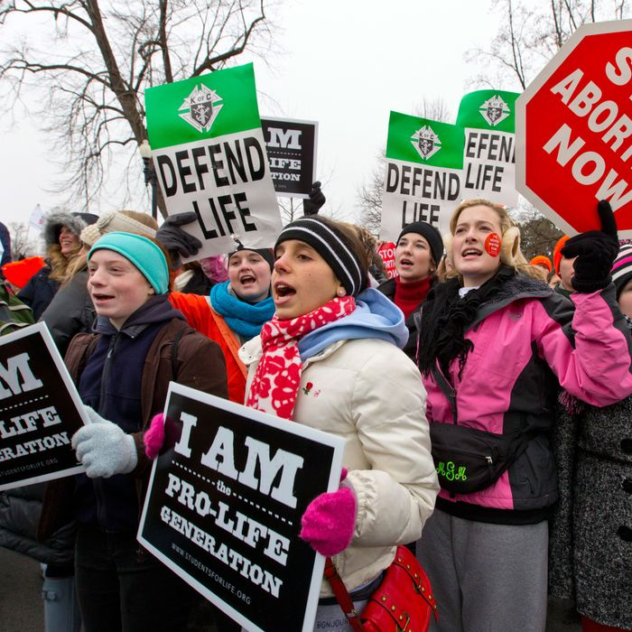 Anti-abortion activists march past the U.S. Supreme Court as they observe the 40th anniversary of the Roe v. Wade decision, in Washington, Friday, Jan. 25, 2013.