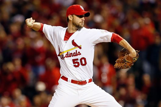 ST LOUIS, MO - OCTOBER 18:  Starting pitcher Adam Wainwright #50 of the St. Louis Cardinals pitches in the first inning against the San Francisco Giants in Game Four of the National League Championship Series at Busch Stadium on October 18, 2012 in St Louis, Missouri.  (Photo by Kevin C. Cox/Getty Images)