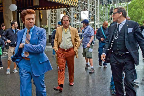Jeremy Renner sporting a Pompadour and with Christian Bale by his side sporting a combover.