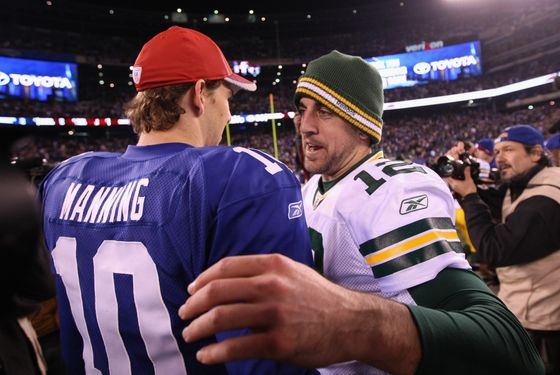 EAST RUTHERFORD, NJ - DECEMBER 04:  (L-R) Eli Manning #10 of the New York Giants congratulates Aaron Rodgers #12 of the Green Bay Packers after the Packers won 38-35 at MetLife Stadium on December 4, 2011 in East Rutherford, New Jersey.  (Photo by Al Bello/Getty Images) *** Local Caption *** Aaron Rodgers; Eli Manning