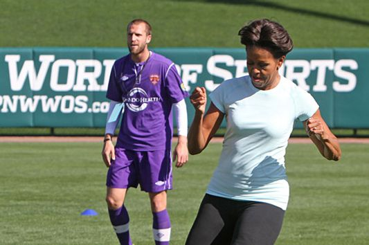 First lady Michelle Obama plays soccer during her visit to the ESPN Wide World of Sports Complex