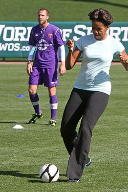 "First lady Michelle Obama plays soccer during her visit to the ESPN Wide World of Sports Complex at Walt Disney World in Lake Buena Vista, Florida, Saturday, February 11, 2012. Obama played various sports with students to promote her ""Let's Move!"" health initiative. (Joe Burbank/Orlando Sentinel/MCT via Getty Images)"