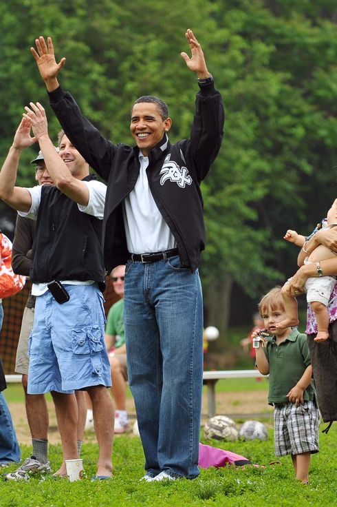 US President Barack Obama (C) celebrates after his daughter Sasha's soccer team scored a goal during a game in Georgetown, May 16, 2009 in Washington, DC.  AFP PHOTO/Mandel NGAN (Photo credit should read MANDEL NGAN/AFP/Getty Images)