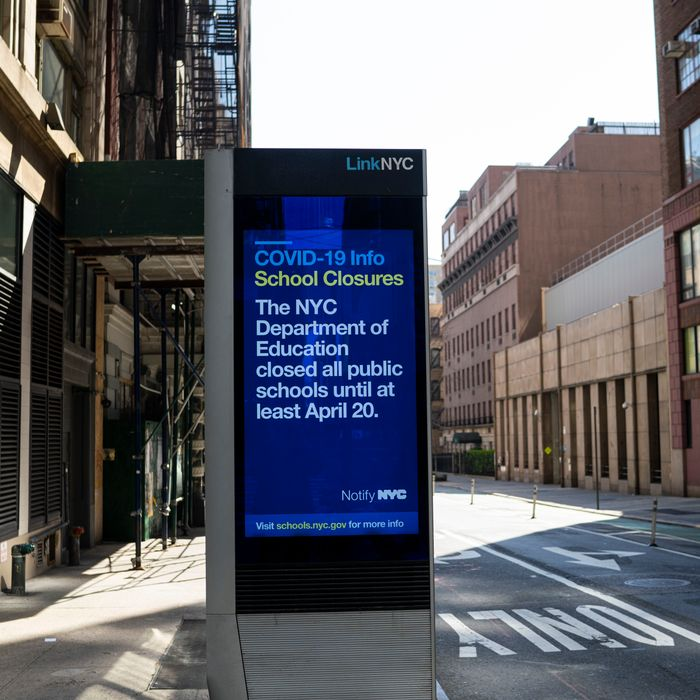 A bus stop sign notes the public schools of New York City have been closed on March 18, 2020. There are 1,100,000 students in New York City's 1,722 public schools.