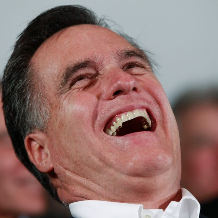 Republican presidential candidate, former Massachusetts Gov. Mitt Romney, laughs as Sen. John McCain, R-Ariz., tells jokes as he campaigns in Hilton Head, S.C., Friday, Jan. 13, 2012.