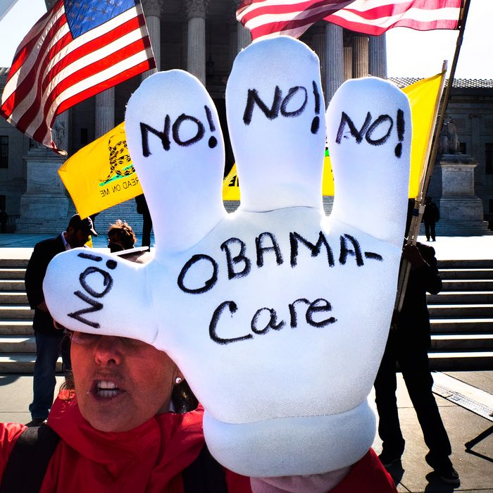 A Tea-Party supporter protest outside the US Supreme Court on the third day of oral arguments over the constitutionality of the Patient Protection and Affordable Care Act on March 28, 2012 in Washington, DC.