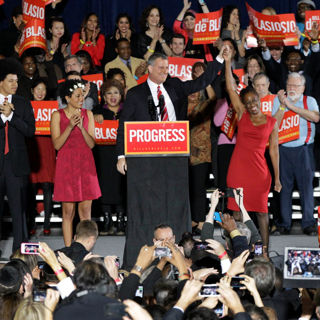Democratic Mayor-elect Bill de Blasio and his family acknowledge supporters after de Blasio was elected the first Democratic mayor of New York City in 20 years in the Brooklyn borough of New York, Tuesday, Nov. 5, 2013.  De Blasio, who beat out Republican Joe Lhota by a large margin, follows the three-term reign of Republican-turned-independent billionaire Michael Bloomberg, and Republican Rudy Giuliani, who led the city in the wake of the 2001 terrorist attacks. (AP Photo/Kathy Willens)