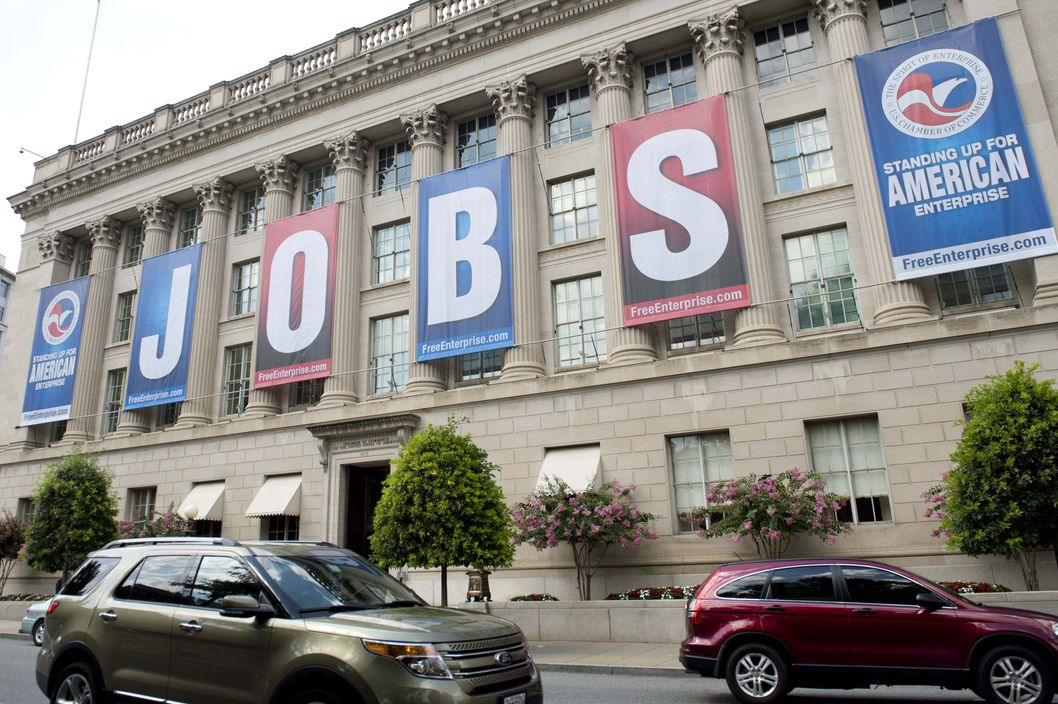 A Jobs sign is seen on the US Chamber of Commerce Building in Washington, DC, on August 2, 2013. The US unemployment rate fell to a four-year low of 7.4 percent in July as the economy added 162,000 jobs, the Labor Department said Friday in a weaker-than-expected report.