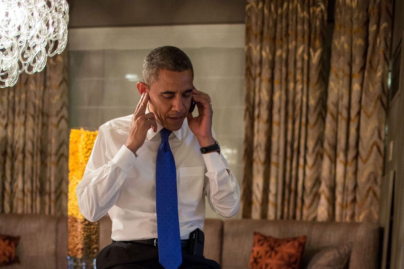 President Barack Obama talks on the phone with former Massachusetts Gov. Mitt Romney in the Presidential Suite at the Fairmont Chicago Millennium Park in Chicago, Ill., Nov. 6, 2012.