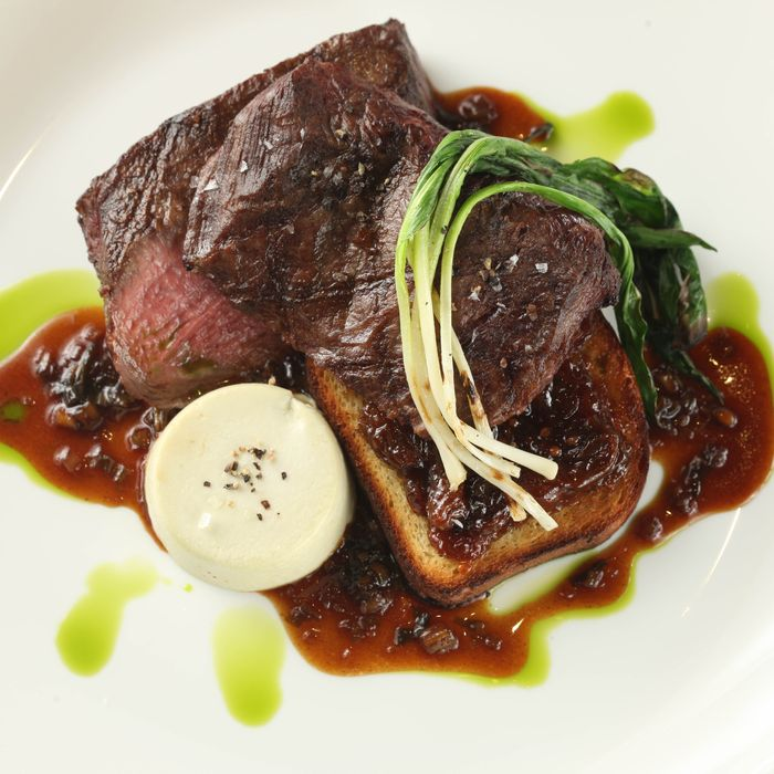 Beautique's steak arrives with bone-marrow flan, grilled ramps, <i>and</i> ramp jus.