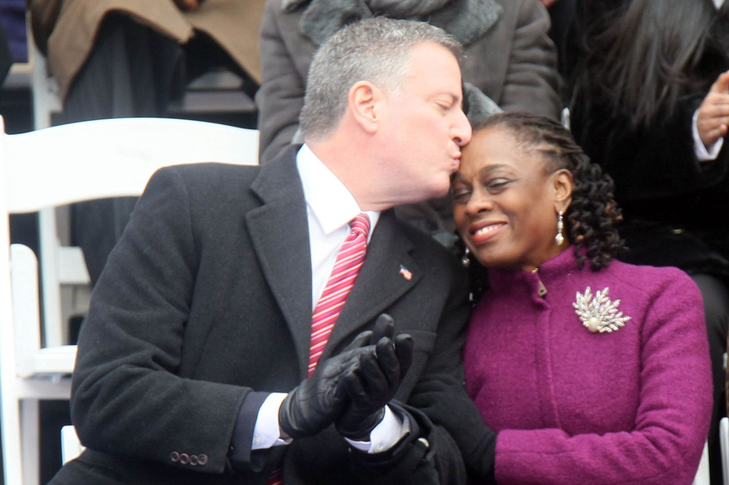 NEW YORK, NY - JANUARY 01: Bill De Blasio and his wife Chirlane De Blasio at the inaguration ceremony on the steps of City Hall making him NYC's 109th mayor on January 1, 2014 in New York City.  (Photo by Steve Sands/WireImage)