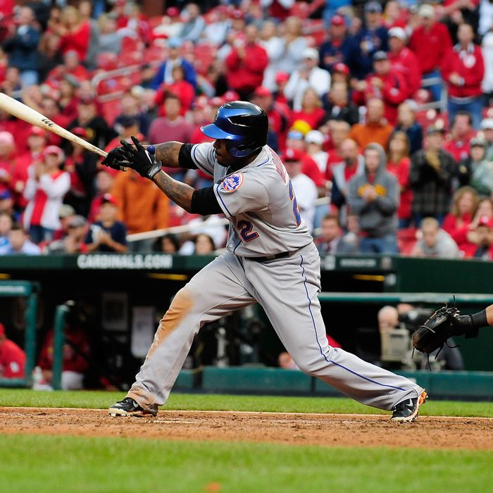 Willie Harris #22 of the New York Mets hits a game winning two run single against the St. Louis Cardinals at Busch Stadium on September 22, 2011 in St. Louis, Missouri.