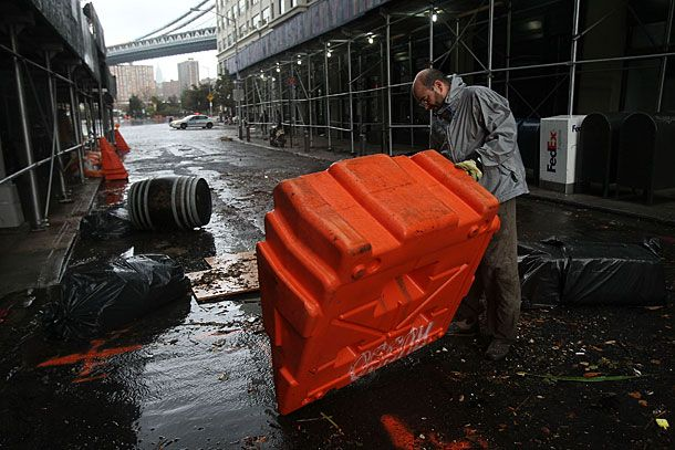 NEW YORK, NY - OCTOBER 30:  Portable, upended flood dikes are viewed on a flooded street in the Dumbo section of Brooklyn after the city awakens to the affects of Hurricane Sandy on October 30, 2012 in New York, United States. At least 15 people were reported killed in the United States by Sandy as millions of people in the eastern United States have awoken to widespread power outages, flooded homes and downed trees. New York City was his especially hard with wide spread power outages and significant flooding in parts of the city.  (Photo by Spencer Platt/Getty Images)