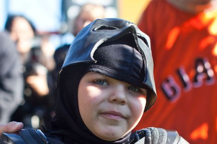 SAN FRANCISCO, CA - NOVEMBER 15: Leukemia survivor Miles, 5, dressed as BatKid, visits AT&T Park as part of a Make-A-Wish foundation fulfillment November 15, 2013 in San Francisco. The Make-A-Wish Greater Bay Area foundation turned the city into Gotham City for Miles by creating a day-long event bringing his wish to be BatKid to life. (Photo by Ramin Talaie/Getty Images)