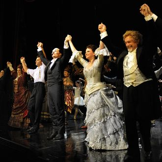 Cast members take a bow at the end of the show marking the 9,000th performance of