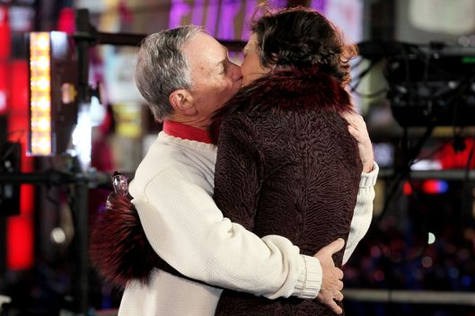 Mayor Michael Bloomberg and Diana Taylor embrace onstage at New Year's Eve 2012 in Times Square on December 31, 2011 in New York City.