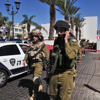 Israeli soldiers secure the area near the site of a shooting incident at a hotel in the Red Sea resort town of Eilat, Israel, Friday, Oct. 5, 2012. A young American opened fire in a hotel in Eilat Friday, killing one person before police shot him dead in an incident that appeared to be a personal dispute.