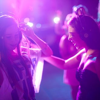 TEL AVIV, ISRAEL - JULY 12: (Israel out) Israeli Youths Celebrate Summer At Silent Disco party on July 12, 2011 in Tel Aviv, Israel. In order to prevent excess noise from bothering others within the surrounding neighborhood, youth wear headphones synchronized to the music while dancing amongst one another. (Photo by Uriel Sinai/Getty Images)