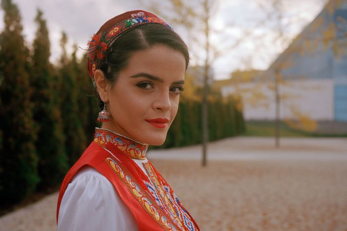 Nilofar, 26, wears a traditional embroidered Tajik dress.