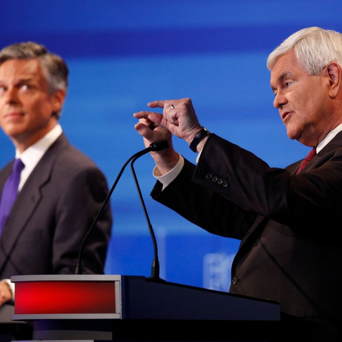 AMES, IA - AUGUST 11: Republican presidential candidates former House Speaker Newt Gingrich (R) and former Utah Gov. Jon Huntsman are pictured during the Iowa GOP/Fox News Debate on August 11, 2011 at the CY Stephens Auditorium in Ames, Iowa. This is the first Republican presidential debate in the state ahead of Saturday's all important Iowa Straw Poll. (Charlie Neibergall-Pool/Getty Images)